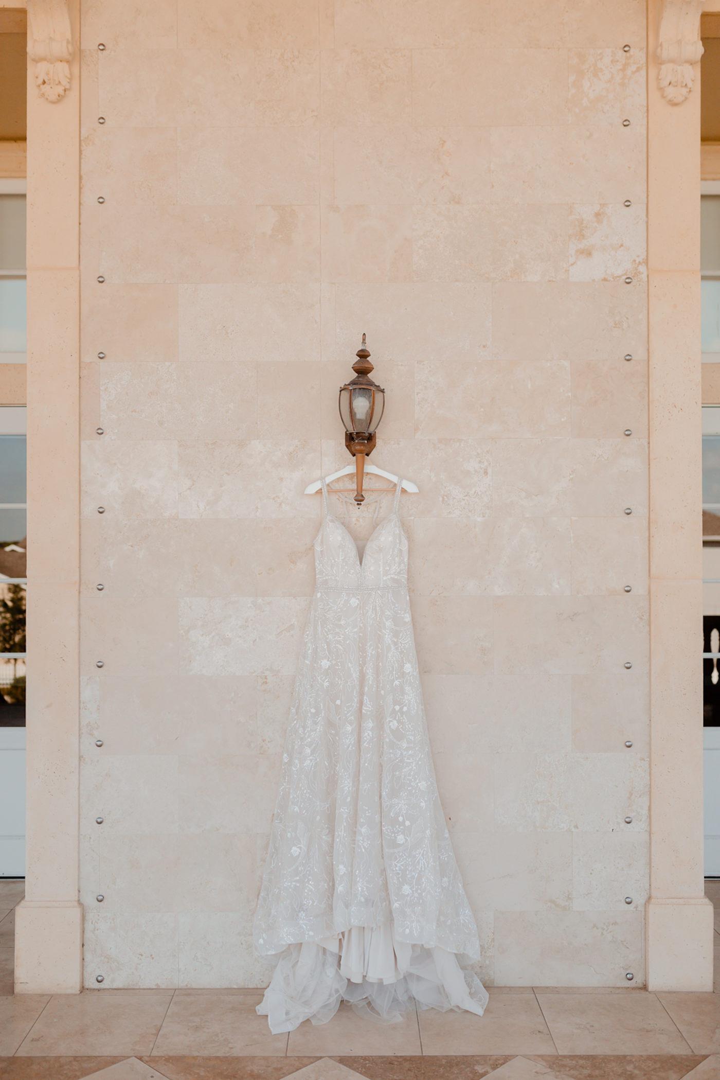 Boho Glam Wedding Dress | Wedding Dress Hanger Shot with Embroidered Floral Lace V Neck Bridal Gown