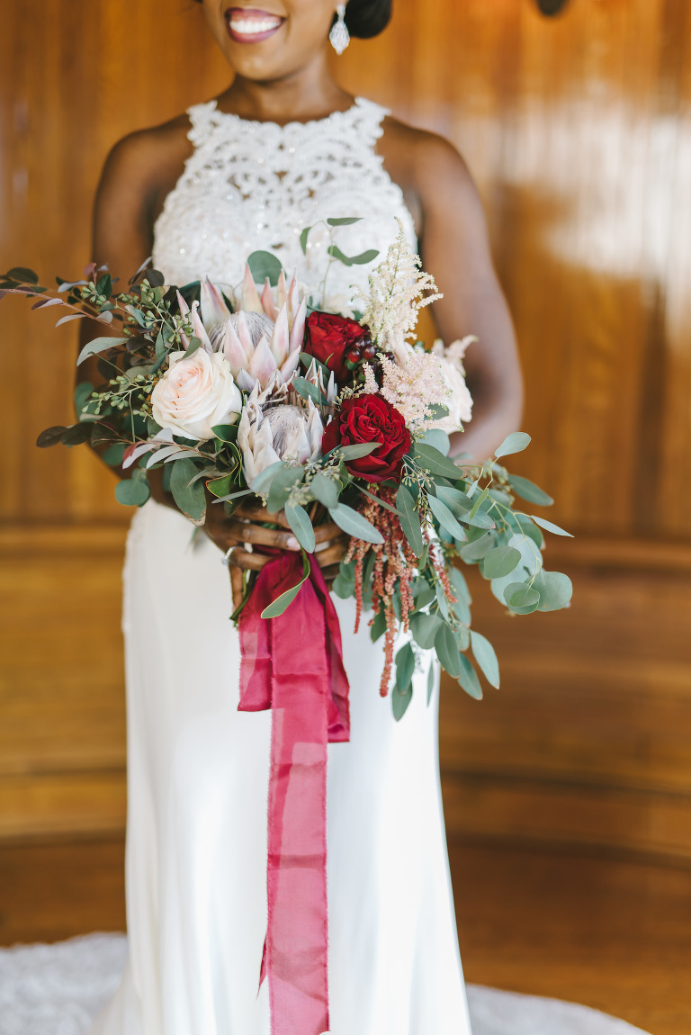 Romantic Florida Bridal Bouquet with Dark Red Roses, Magenta Flowers, Blush Pink King Protea, Magenta Flowers, Boysenberry Accents, with Eucalyptus Leaf Greenery | Sarasota Wedding Photographer Kera Photography
