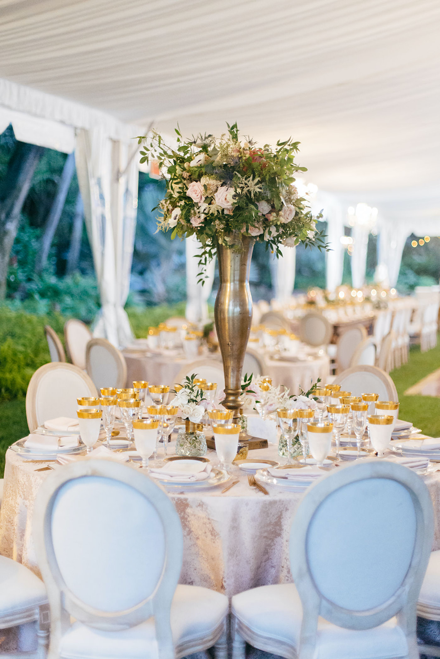 Elegant Florida Wedding Decor and Reception, Long Feasting Table for Wedding Party, Modern Circle Back Chairs, Crystal Chandeliers, Luxurious Blush Pink Florals and Greenery, Gold Table Setting Accents   Sarasota Wedding Planner NK Weddings   Marie Selby Botanical Gardens