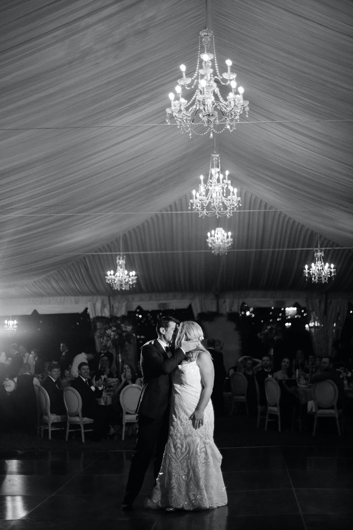 Sarasota Bride and Groom First Dance under Crystal Chandeliers of Tented Outdoor Reception, Black and White   Florida Wedding Planner NK Weddings