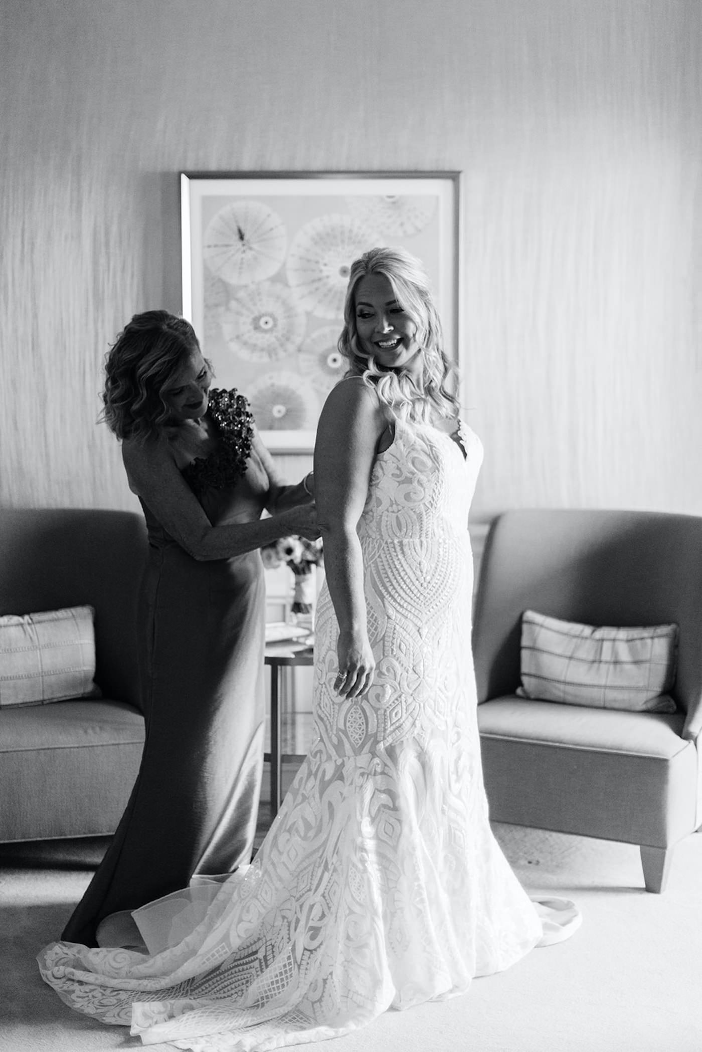 Florida Bride and Mother Getting Ready Photo, Mom Putting On Daughters Dress, Bride Wearing Hayley Paige White and Ivory Wedding Dress with Lace Overlay Detailing