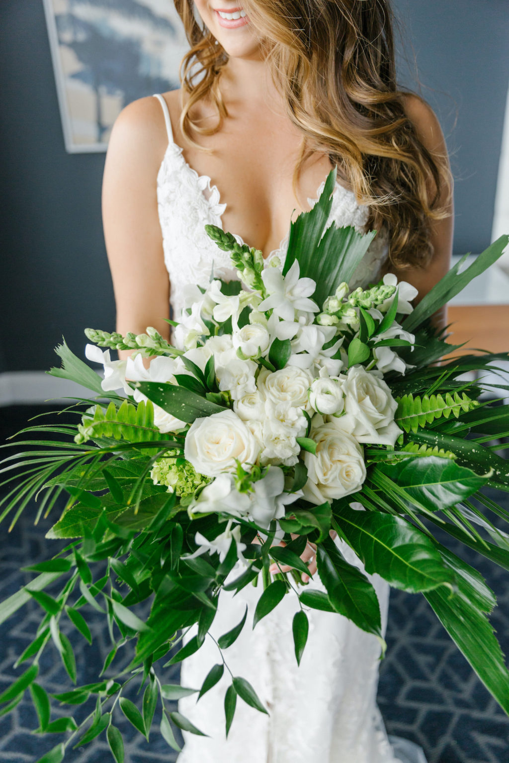 Tampa Wedding Florist Bruce Wayne Florals   Florida Tropical Wedding Bridal Bouquet with Greenery Palm Fronds and Ferns and White Roses Orchids and Snapdragons