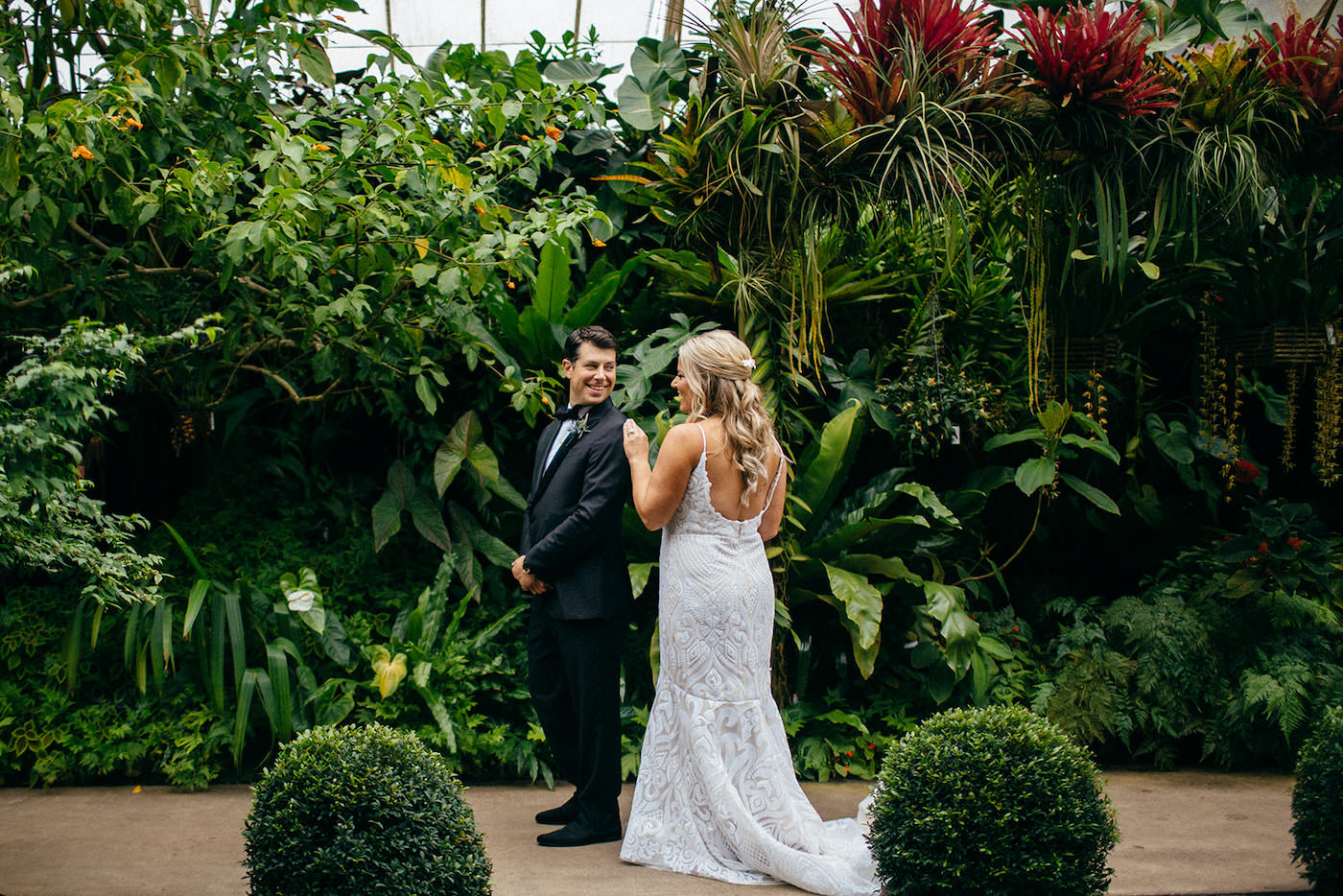Florida Bride and Groom First Look, Bride Wearing Romantic Hayley Paige Wedding Dress, Groom in Classic black Tux   Marie Selby Botanical Gardens