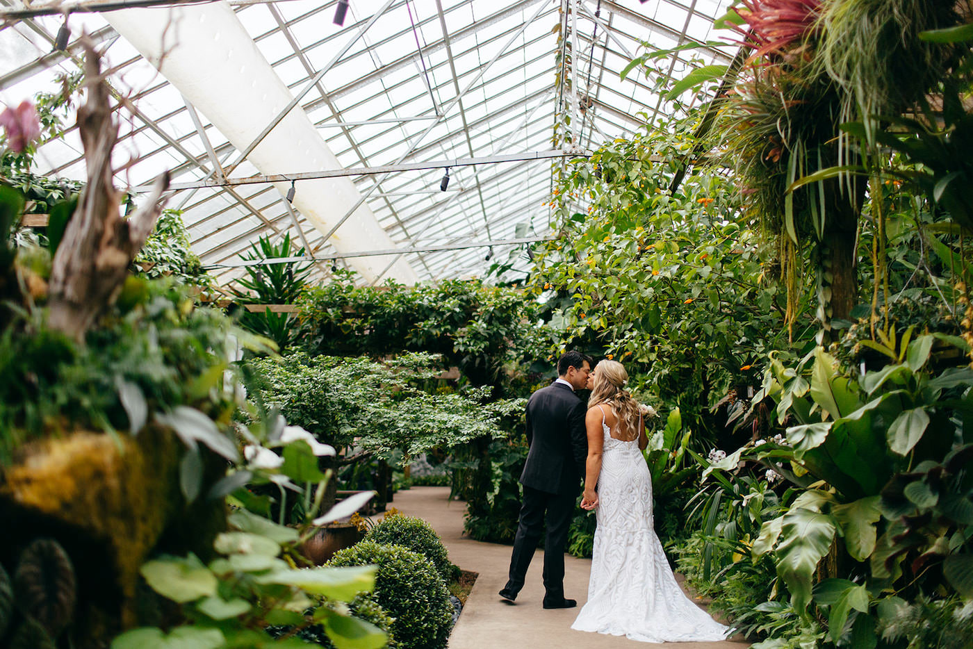Florida Bride and Groom Intimate Embrace Kiss, Bride Wearing Romantic Hayley Paige Wedding Dress, Groom in Classic black Tux   Marie Selby Botanical Gardens