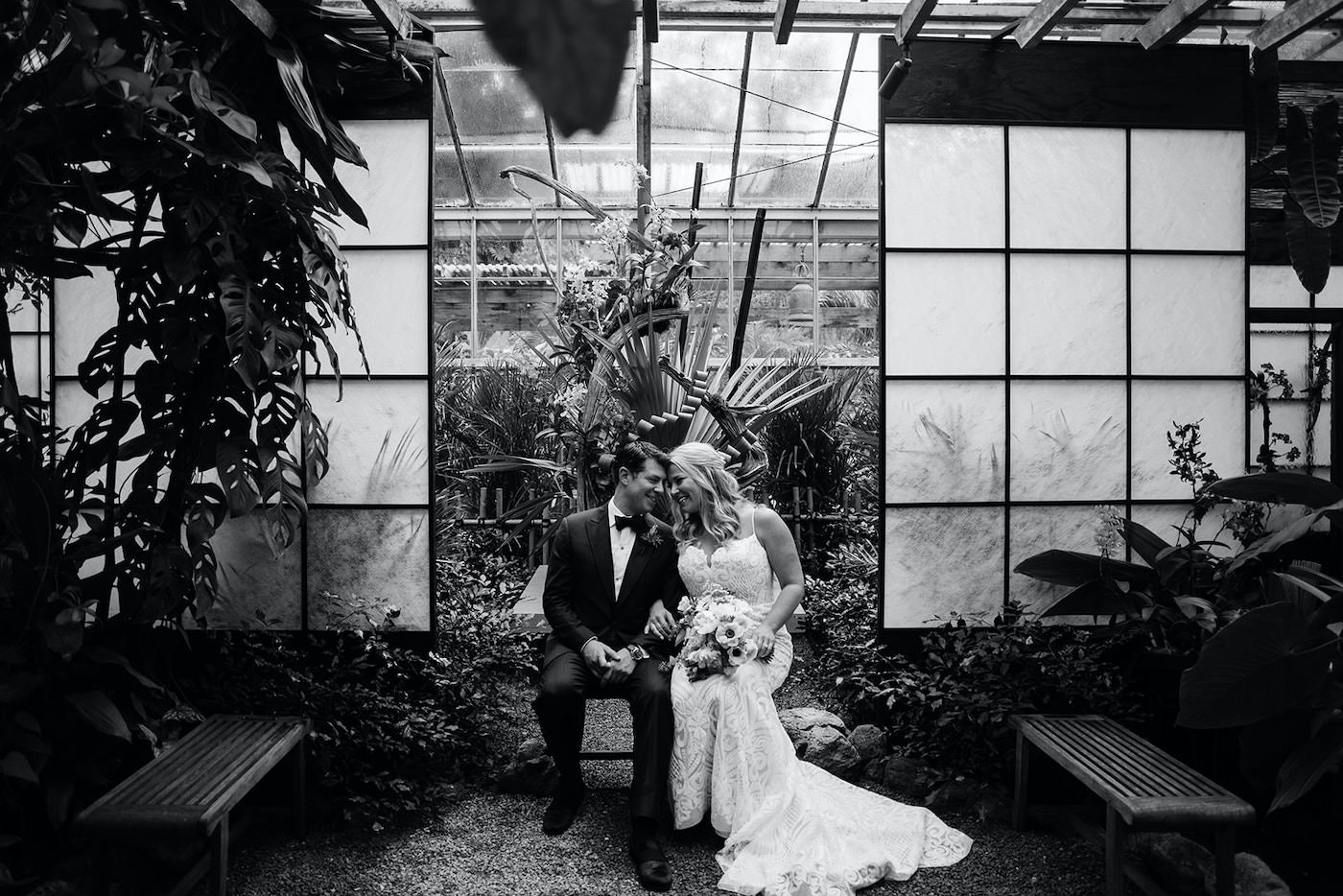 Black and White Florida Bride and Groom Intimate Embrace, Bride Wearing Romantic Hayley Paige Wedding Dress, Groom in Classic black Tux   Marie Selby Botanical Gardens