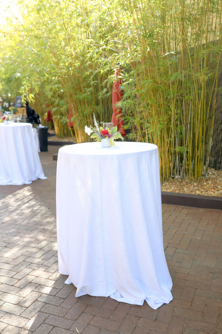 Tall Cocktail Table with White Linen Low Floral and Greenery Centerpiece | St. Pete Unique Wedding Venue Bamboo Courtyard NOVA 535 | Monarch Events and Design