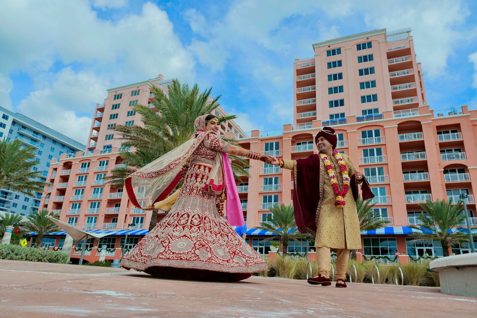 Bride and Groom Outdoor Portrait | Gold Groom Sherwani | Traditional Red and Gold Indian Wedding Dress Lehenga Saree | Indian Wedding at Clearwater Wedding Venue Hyatt Regency Clearwater Beach