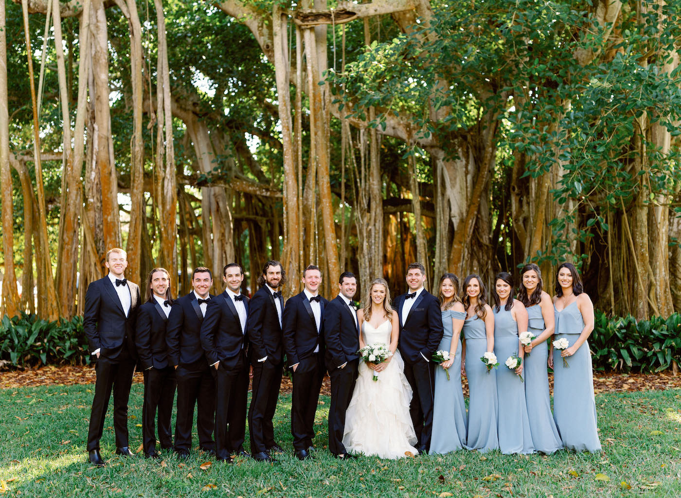 Florida Modern Wedding Party, Large Bridal Party, Bridesmaids in Mix and Match Slate Gray Dresses, Groom and Groomsmen in Classic Back Tuxedos with Bowties | Sarasota Wedding Planner NK Weddings
