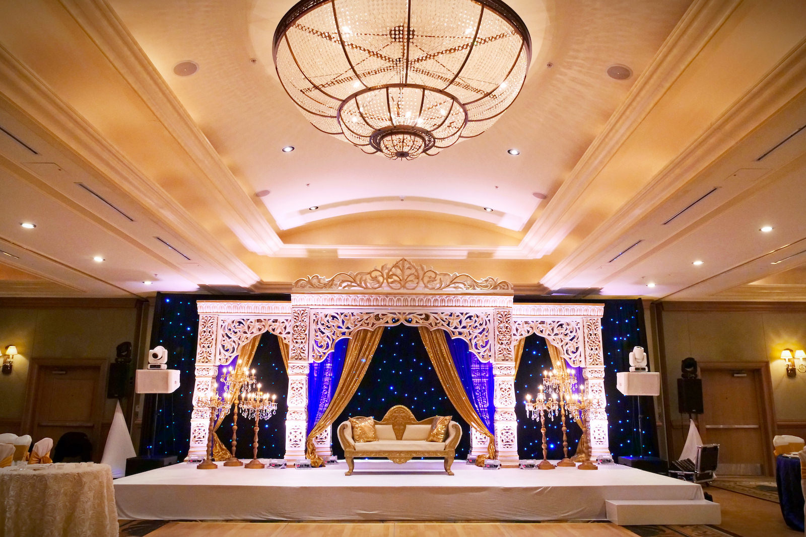 Indian Wedding Reception in Hotel Ballroom | Clearwater Wedding Venue Hyatt Regency Clearwater Beach | White Gold and Blue Indian Wedding Mandap Stage with Gold Candelabras and Gold Loveseat