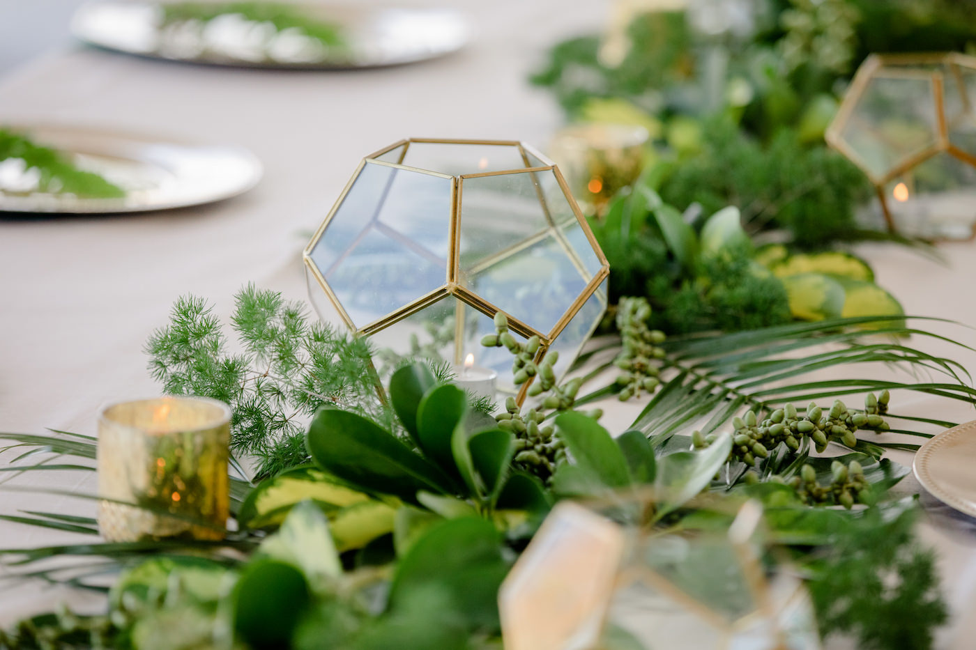 Clearwater Beach Wedding Venue Hilton Clearwater Beach   Modern Tropical Beach Outdoor Wedding Reception Terrace Feasting Table Centerpiece of Tropical Palm Frond Leaf Floral Arrangement Garland and Gold Geometric Candles