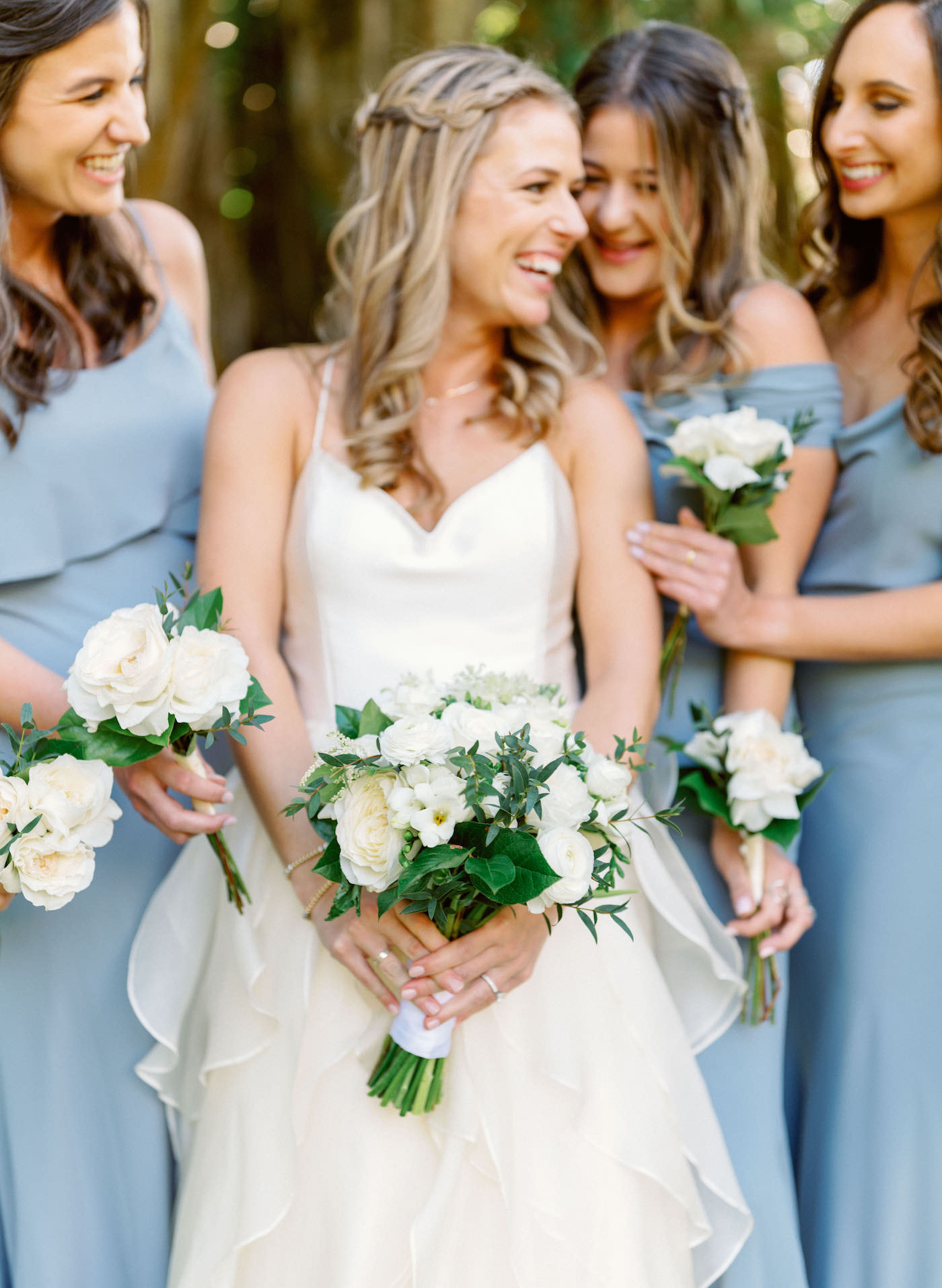 Florida Modern Bridal Party, Bridesmaids in Mix and Match Slate Gray Dresses, Holding Ivory and White Floral Bouquets with Greenery | Sarasota Wedding Planner NK Weddings