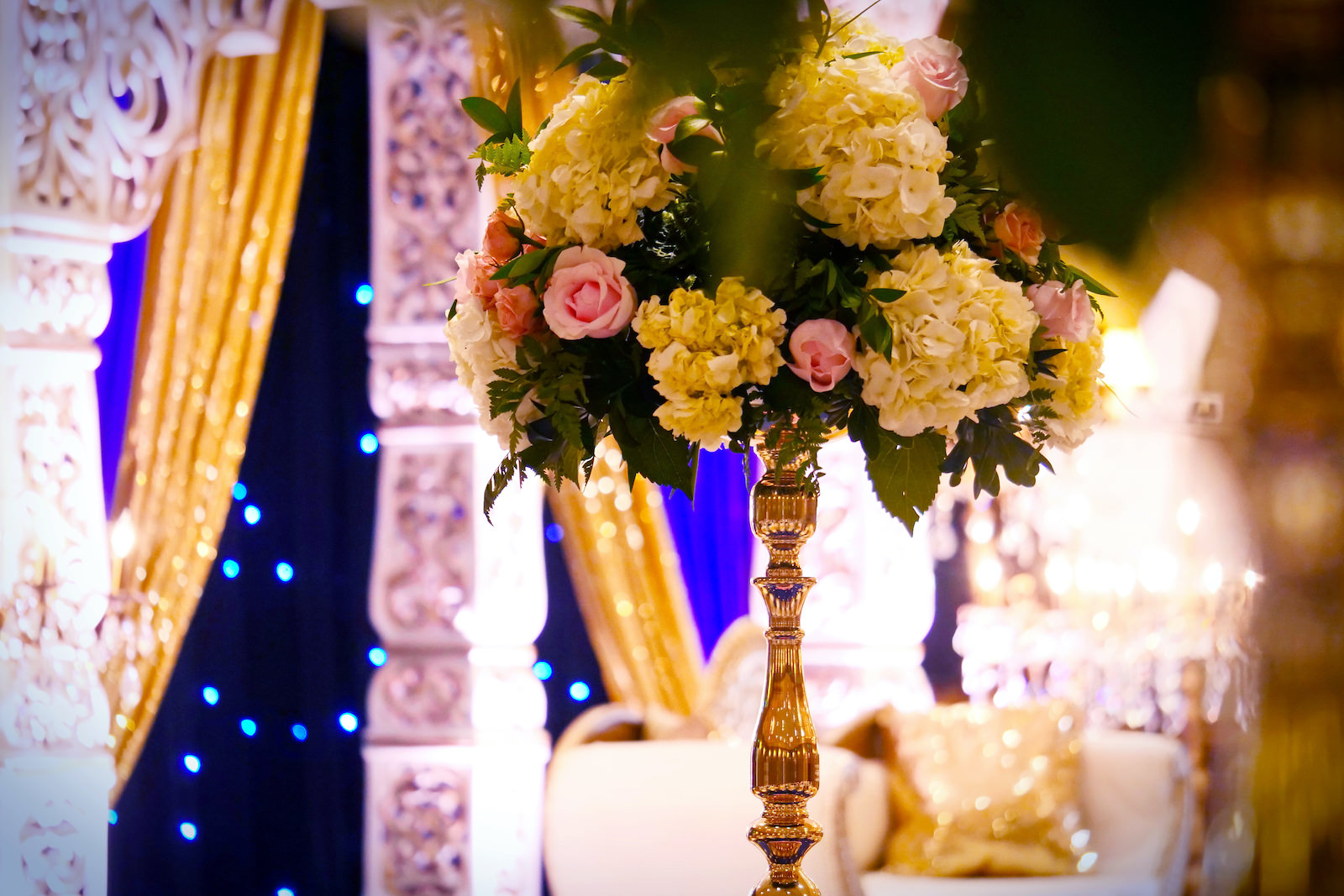 Tall Gold Candlestick Centerpiece with Pink Roses and Ivory Hydrangea | Clearwater Indian Wedding Reception Inspiration