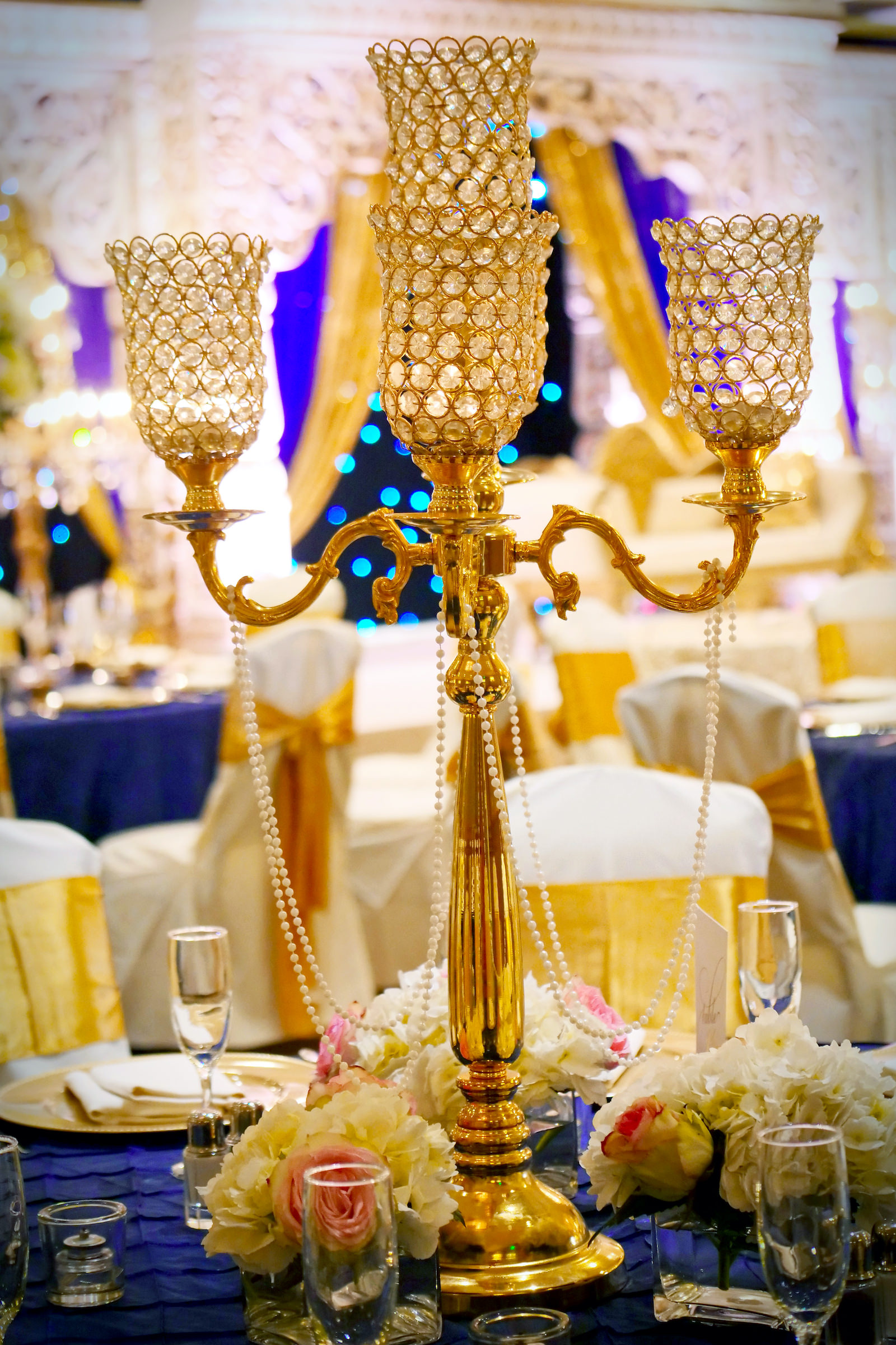 Tall Gold Candelabra Centerpiece with Pearls and Pink Roses and Ivory Hydrangea | Clearwater Indian Wedding Reception Inspiration