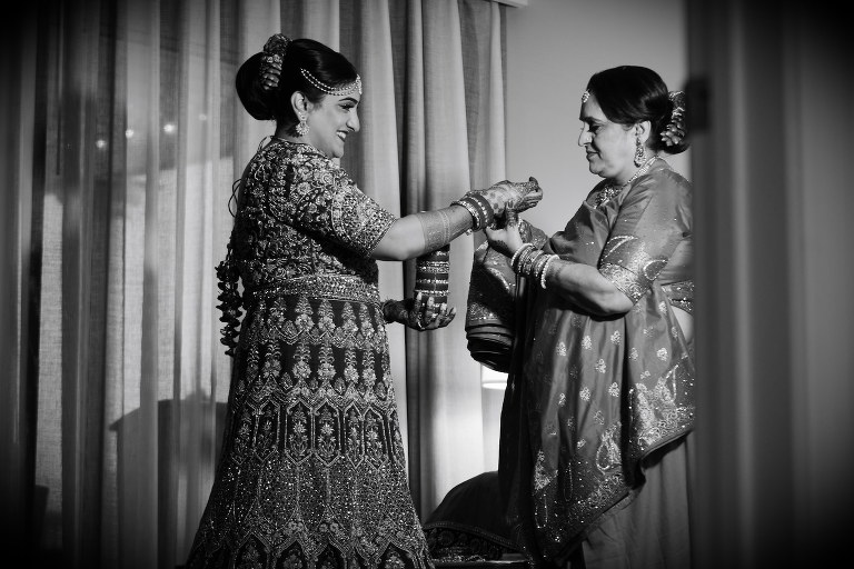 Black and White Wedding Photography | Indian Wedding Tampa Florida | Mother of the Bride Helping Bride Get Dressed