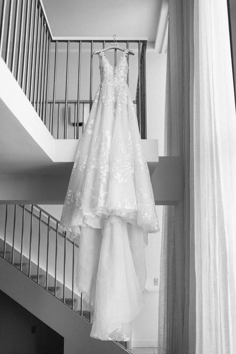Romantic, Fairytale inspired wedding dress hanging from staircase, Galia Lahav Modern Bridal Dress | Florida Luxury Wedding and Dress Boutique Isabel O'Neil Bridal