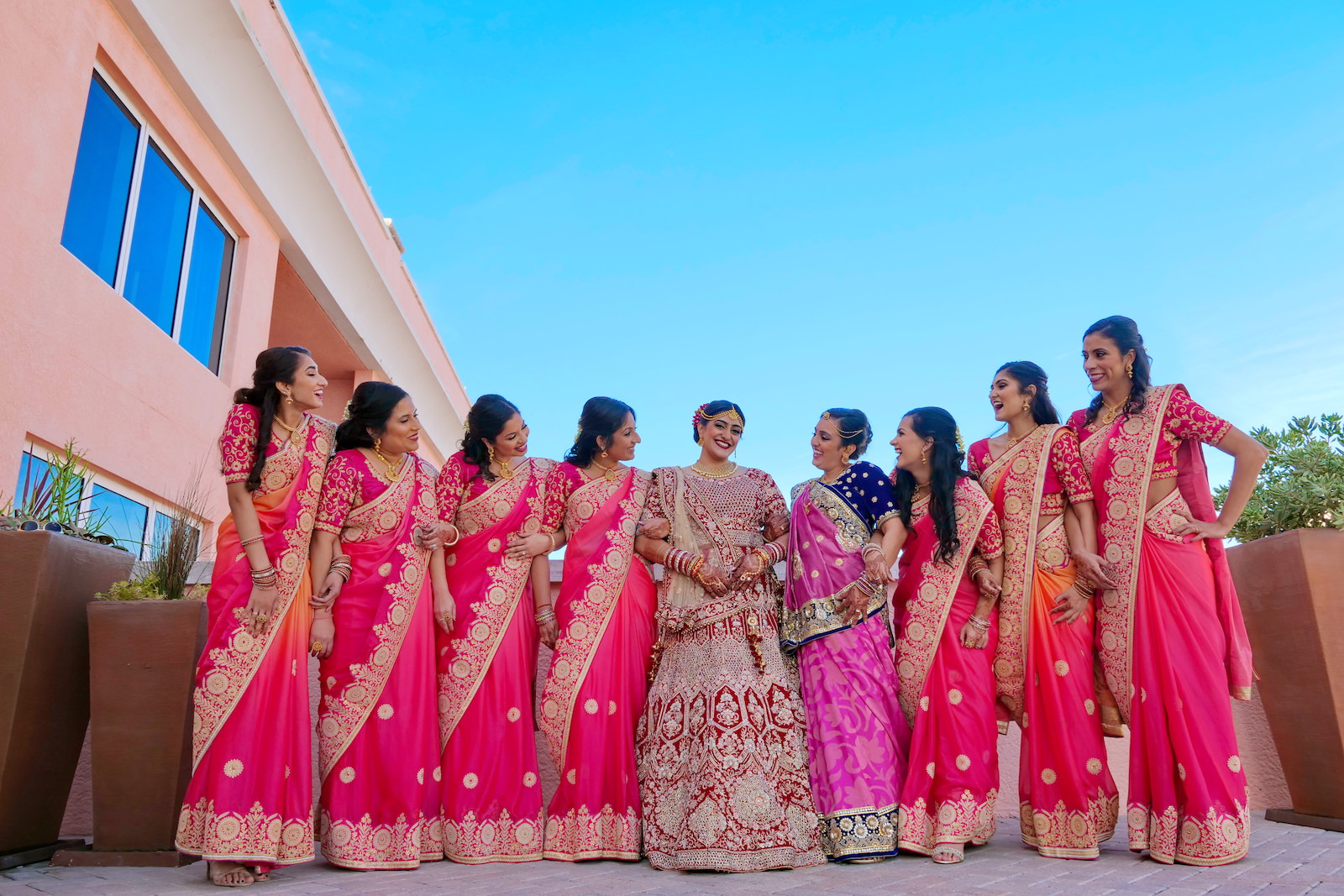 Clearwater Florida Indian Wedding | Bride and Bridesmaids in Traditional Indian Sari Garment Attire Fuchsia Pink and Gold | Tampa Wedding Hair and Makeup Artists Michele Renee The Studio