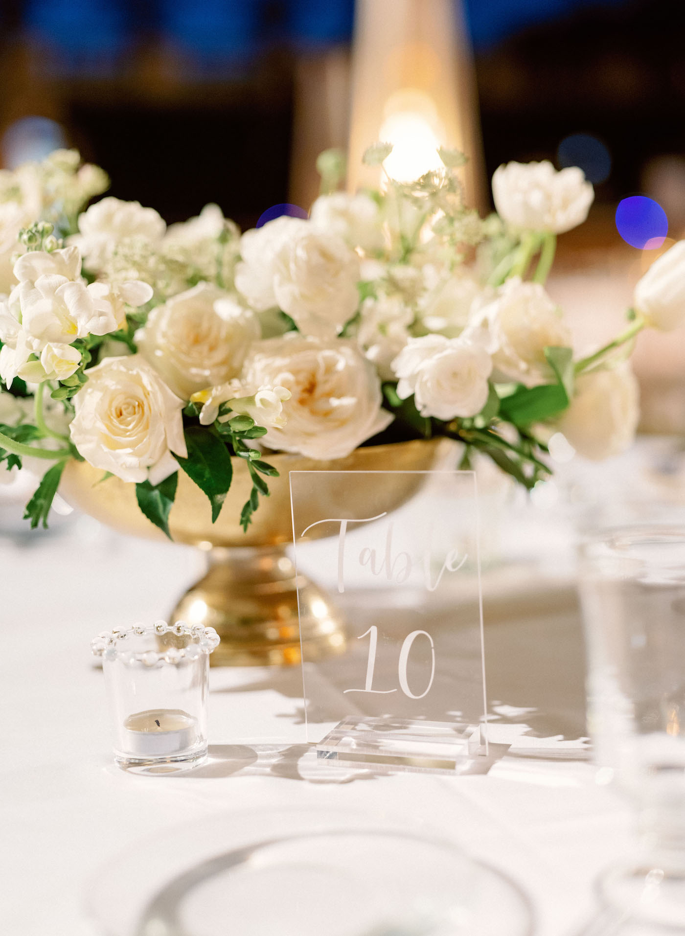 Romantic, Modern Wedding Reception Decor, Low Floral Centerpiece with Gold Vase, Ivory Roses, White Florals and Greenery, Clear Acrylic Table Number | Luxury Florida Wedding Planner NK Weddings