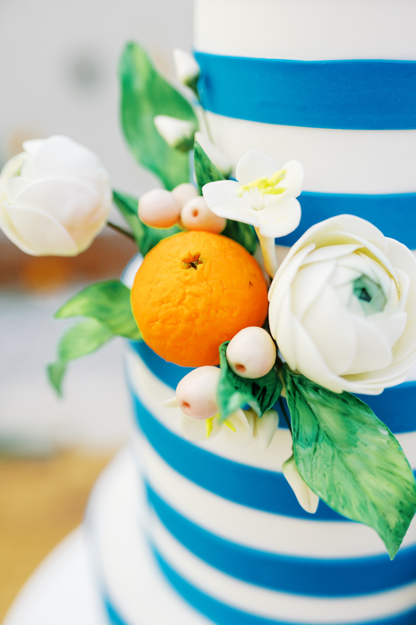 Wood Farm Table Wedding Cake Display | Three Tier Blue and White Stripe Wedding Cake with Fresh Citrus by Tampa Bay Cake Company Bakery | Tropical Florida Citrus Wedding Inspiration