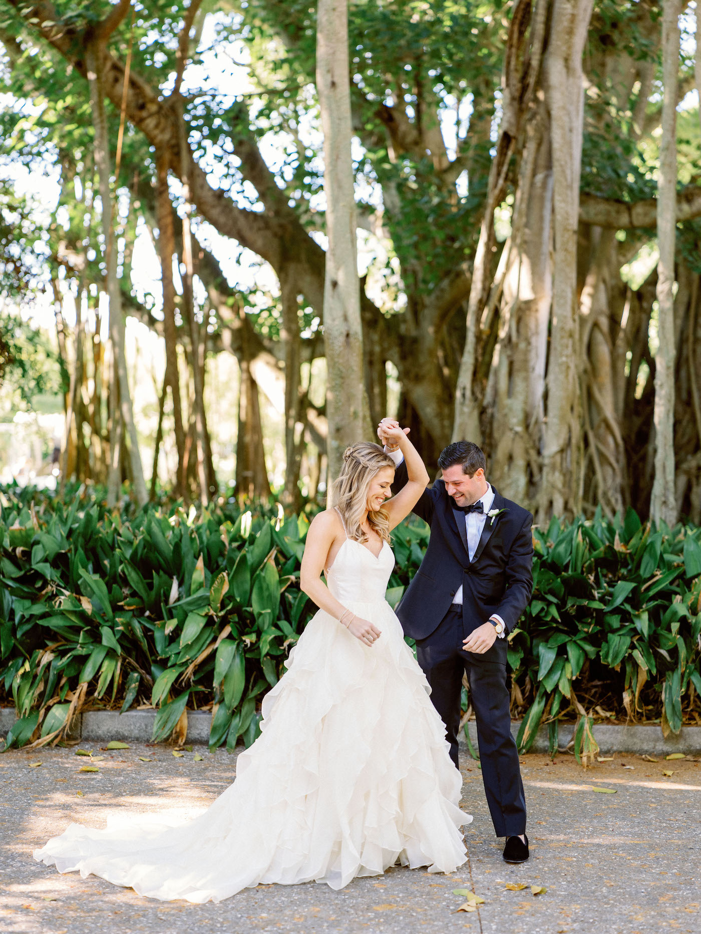 Florida Bride and Groom Dance Outside, Classic Bride and Groom Have Fun Candid Moment Portrait | Sarasota Wedding Planner NK Weddings