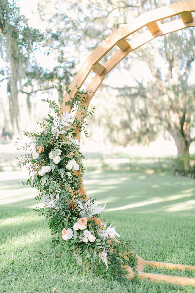 Outdoor Florida At Home Front Back Yard Wedding Ceremony | Round Wood Moon Arch Wedding Ceremony Backdrop with Natural Ivory and Peach Garland Floral Arrangements