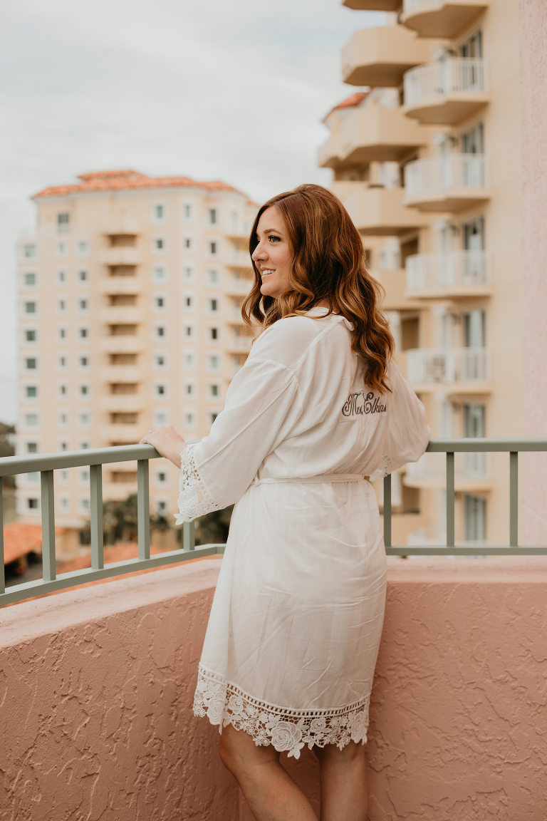 Bride in Monogramed Robe Getting Ready on Wedding Day