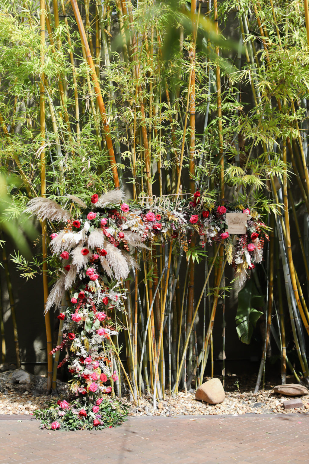 Unique Pampas Grass and Pink Floral Arch in St. Pete Bamboo Courtyard Wedding Venue NOVA 535 | Monarch Events and Design