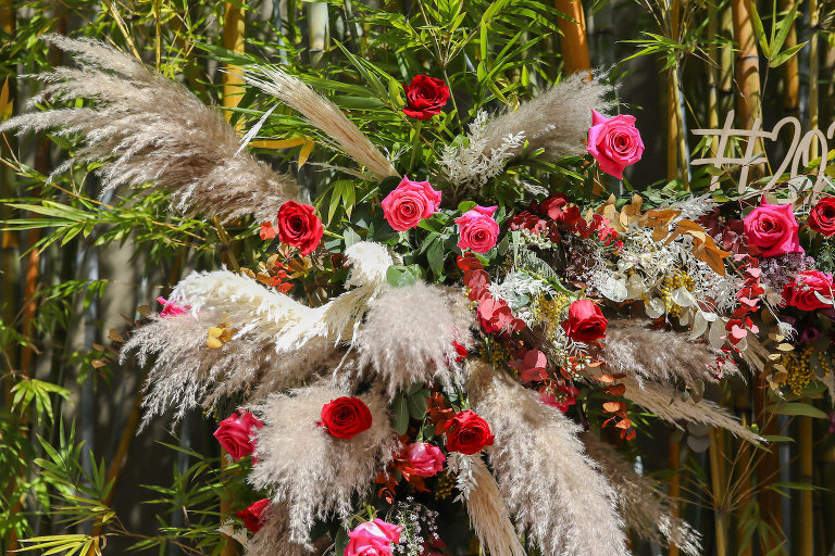 Whimsical Boho Wedding Floral Arrangement with Pampas Grass and Vibrant Roses | Tampa Wedding Florist Monarch Events and Design