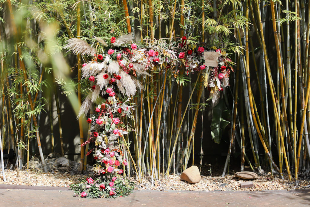 Whimsical Boho Wedding Arch Floral Arrangement with Pampas Grass and Vibrant Roses | Tampa Wedding Florist Monarch Events and Design