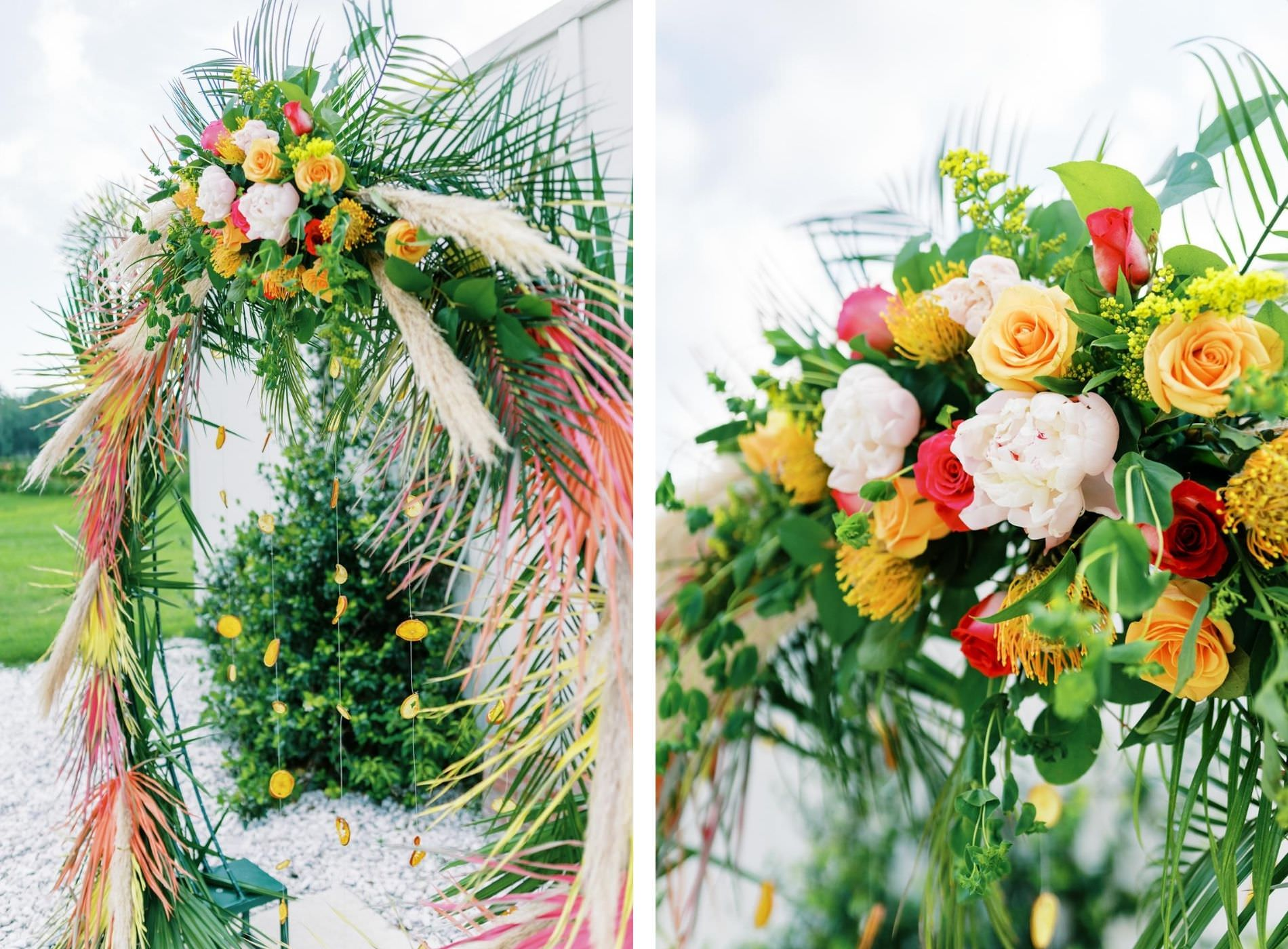 Tropical Florida Citrus Wedding Inspiration | Orange and Yellow Painted Palm Frond Leaf Round Moon Arch Ceremony Backdrop with Pampas Grass and Hanging Orange Slices | Bright Colorful Floral Arrangement with Orange and Pink Roses and Yellow Pincushion Protea