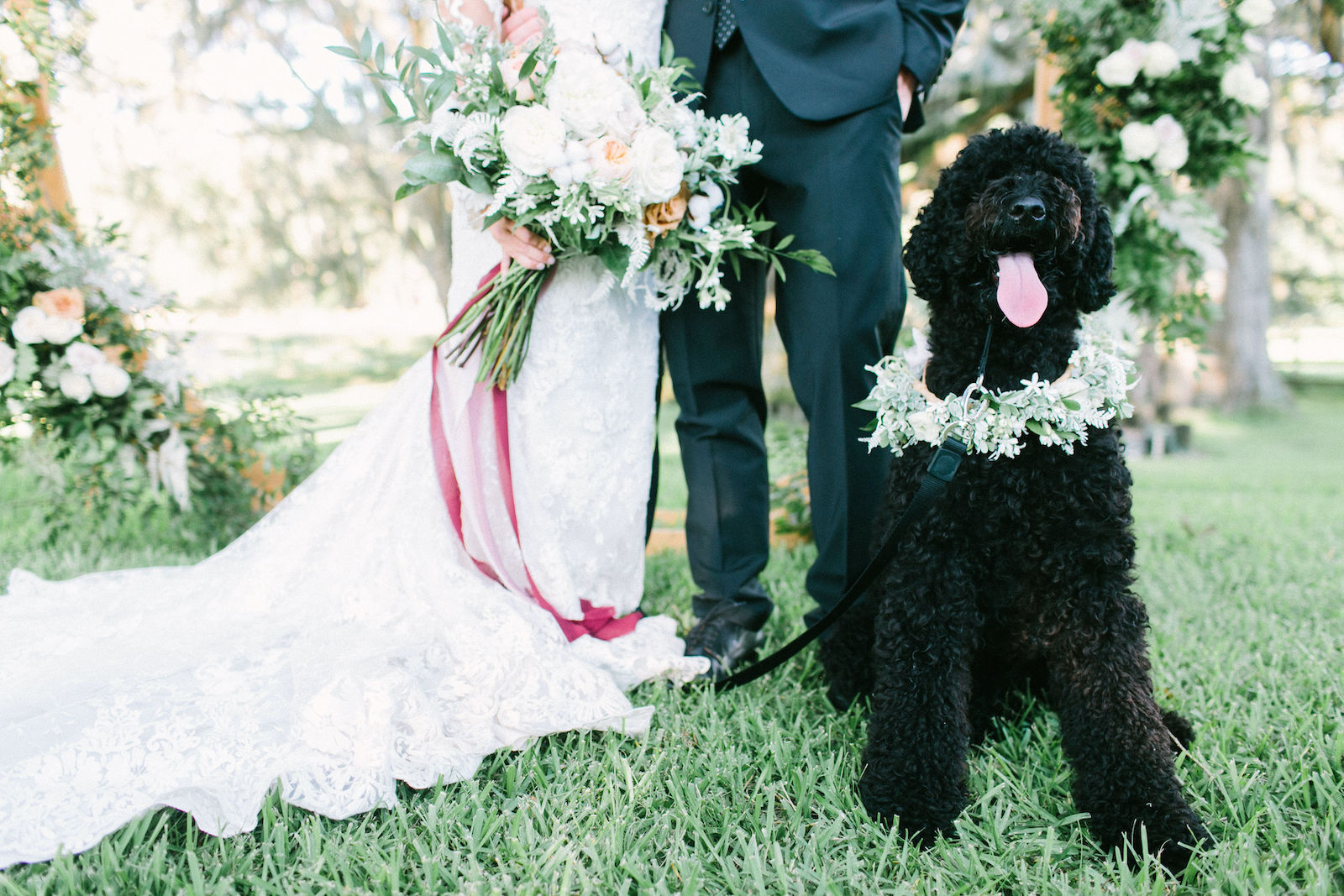 Outdoor Florida Bride and Groom Portrait with Pet Dog Labradoodle | Best Dog of Honor with Floral Collar | Ivory Champagne and Peach Natural Bouquet with Roses Astilbe and Greenery tied with Blush Pink and Mauve Ribbons