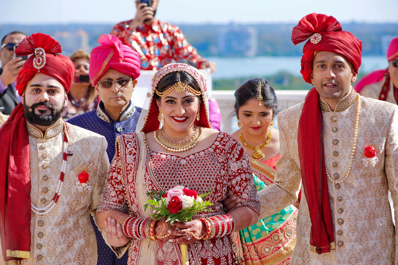 Bride Walking Down Aisle with Brothers during Traditional Indian Wedding Ceremony | Clearwater Florida Indian Wedding | Red and Gold Wedding