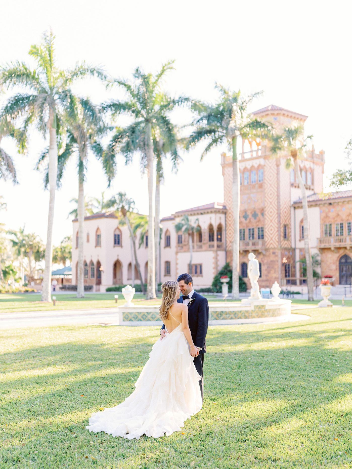 Romantic, Modern Florida Bride and Groom In Courtyard in Ringling Mansion Belvedere Tower | Sarasota Wedding Planner NK Weddings