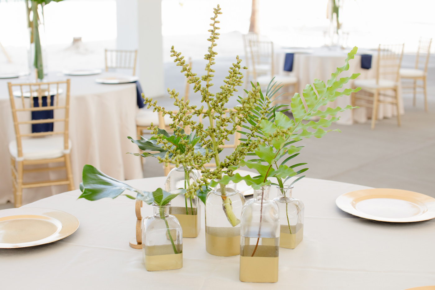 Clearwater Beach Wedding Venue Hilton Clearwater Beach   Modern Tropical Beach Outdoor Wedding Reception Centerpiece with Gold Dipped Bud Vase Bottles of Tropical Palm Frond Leaves
