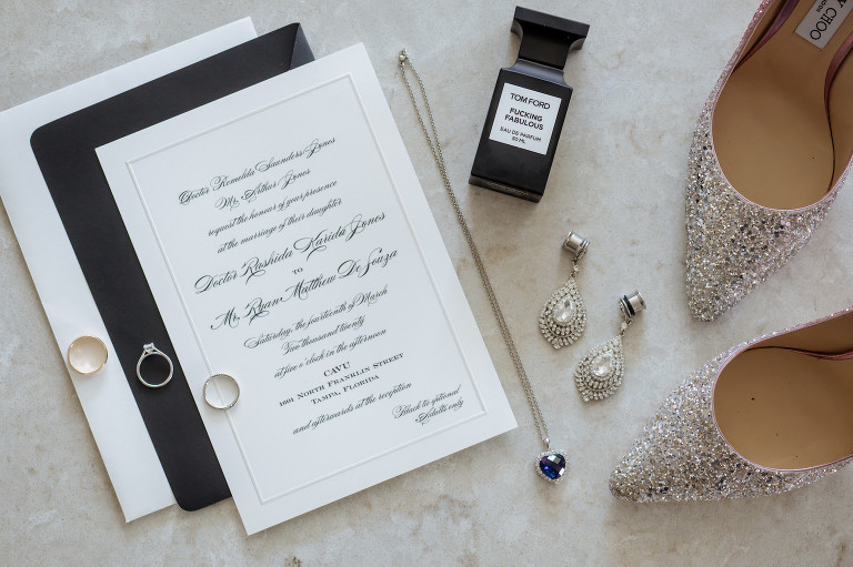 Classic Black and White Wedding Invitation with Calligraphy | Wedding Stationery Flat Lay with Tom Ford Perfume and Glitter Sparkle Jimmy Choo Bride Wedding Shoes