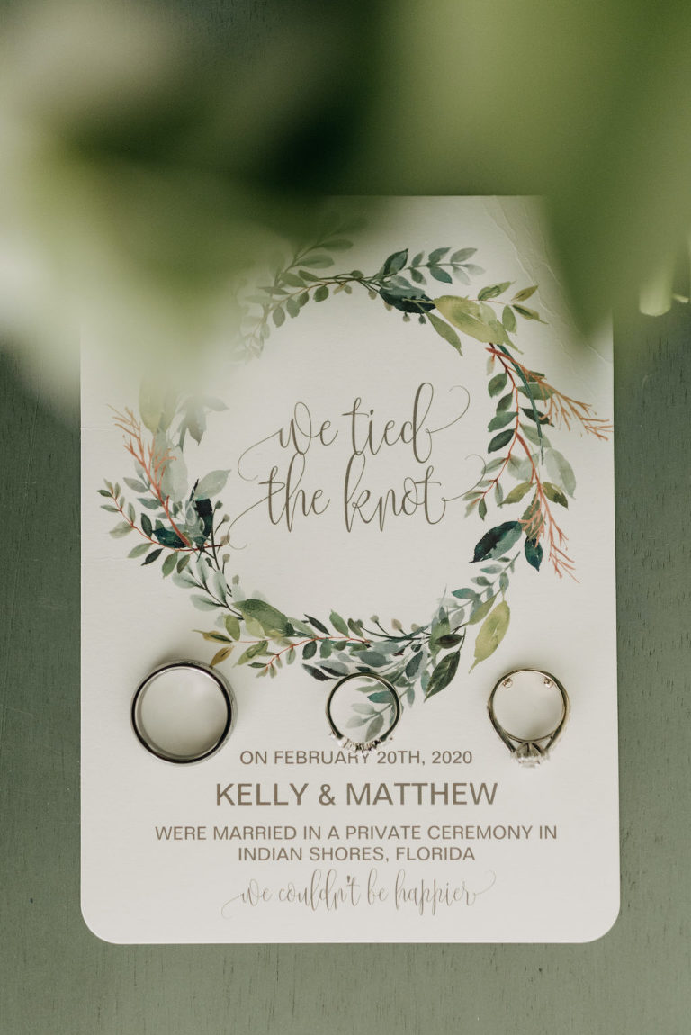 Tampa St Pete Florida COVID Destination Elopement Announcement Stationery with Greenery Motif | Wedding Rings Shot | Indian Shores Wedding Invitation