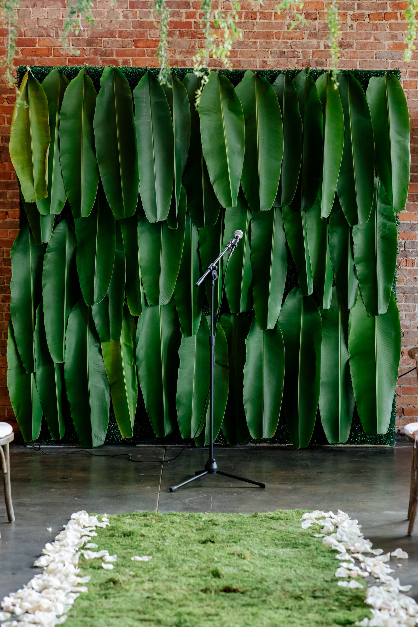 Modern Wedding Ceremony Backdrop with Tropical Palm Leaves and Moss Aisle Runner