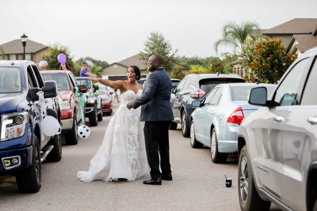Florida Bride and Groom During COVID Wedding Reception, Drive By Honk and Cheer for The Newlyweds at Valrico Private Residence Reception | Tampa Bay Wedding Photographer Lifelong Photography Studios | Ballgown Lace and Tulle Wedding Dress Isabel O'Neil Bridal