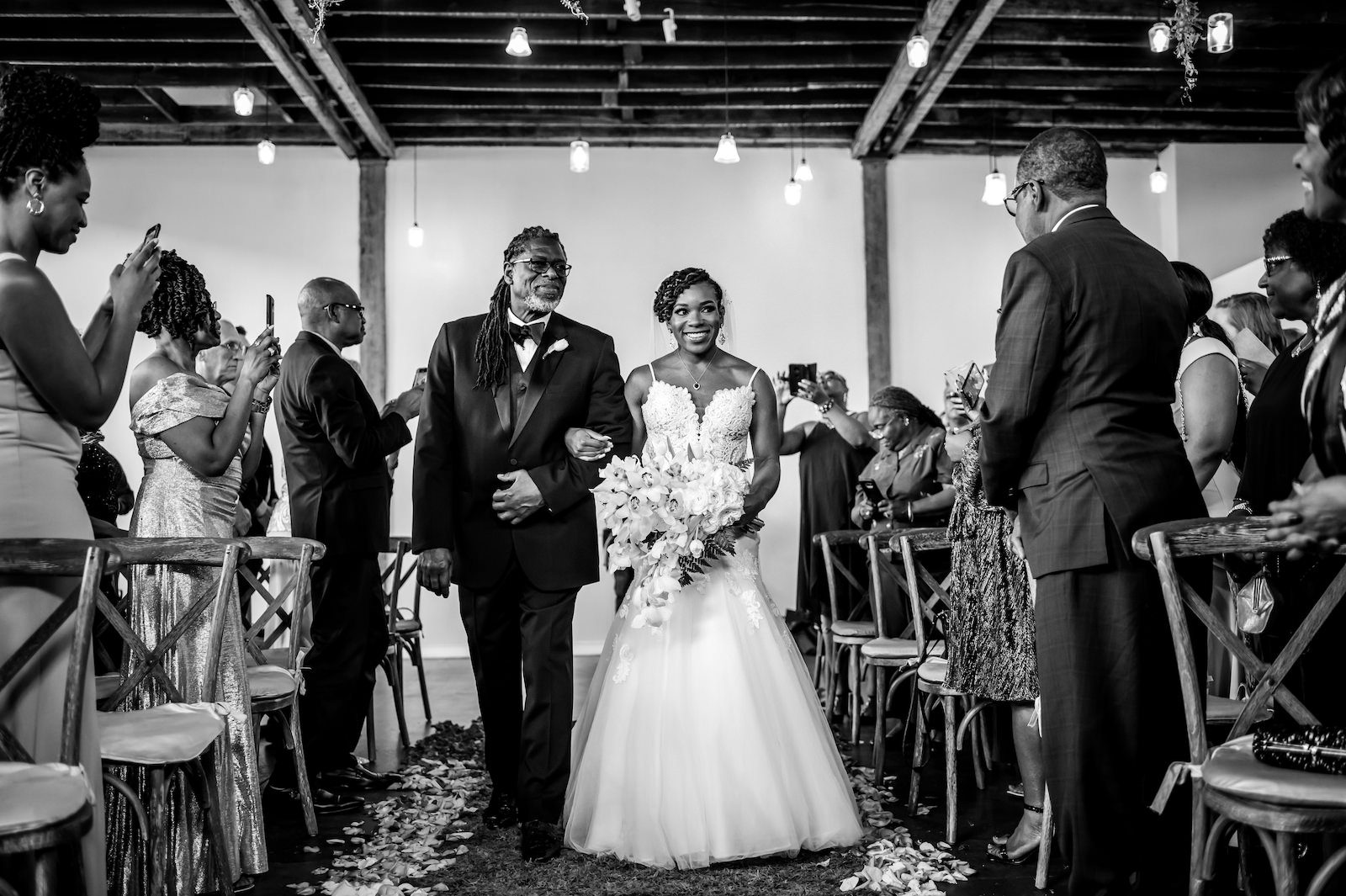 Bride Walking Down Aisle with Father during Indoor Tampa Heights Wedding Ceremony   Black and White Wedding Photography