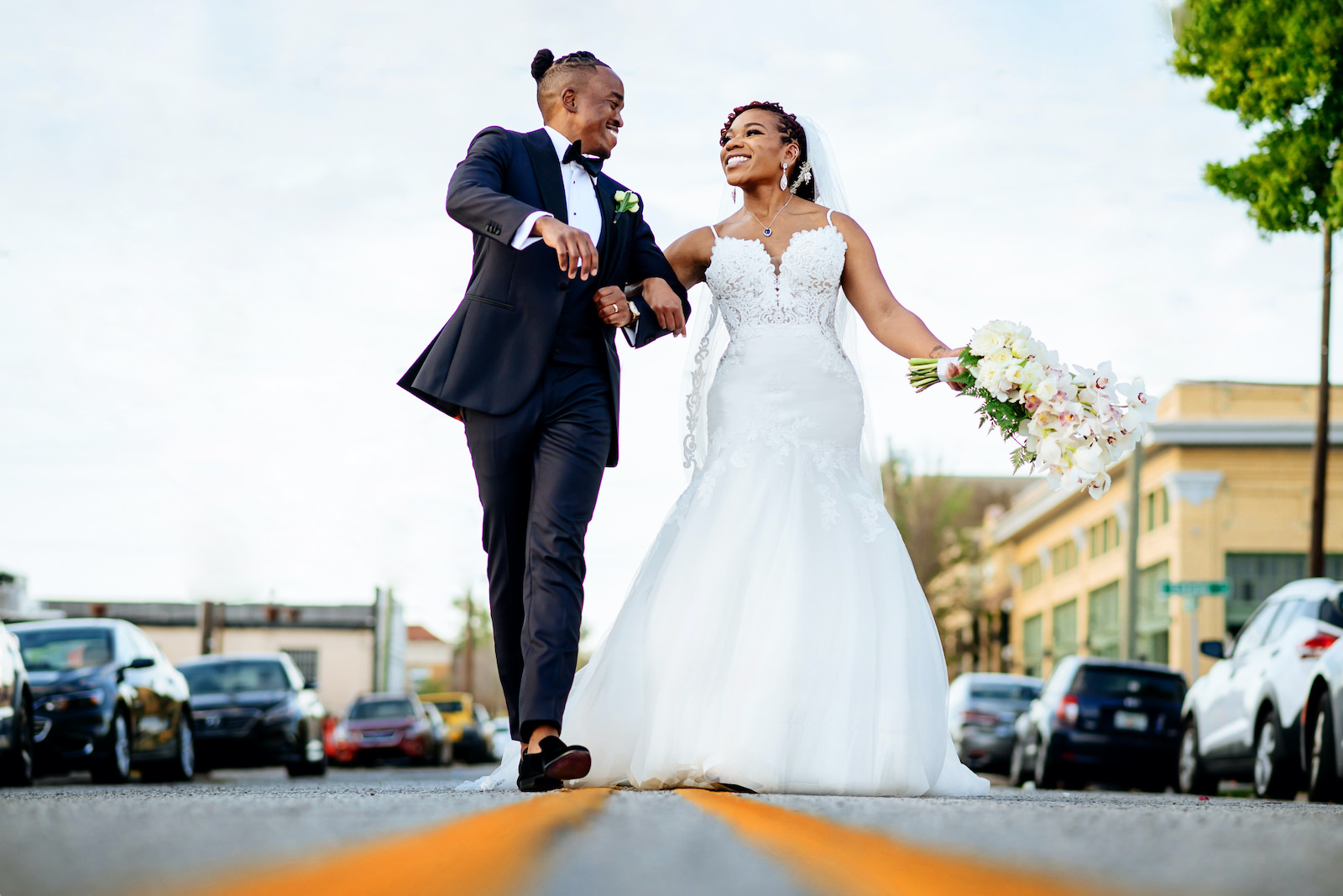 Outdoor Tampa Heights Bride and Groom Portrait   Ivory Spaghetti Strap Scoop Back Lace and Tulle Mermaid Martina Liana Wedding Dress Bridal Gown   Groom in Modern Navy Suit with Black Satin Lapel and Bow Tie   White Arm Sheaf Wedding Bride Bouquet with Hydrangea and Orchids