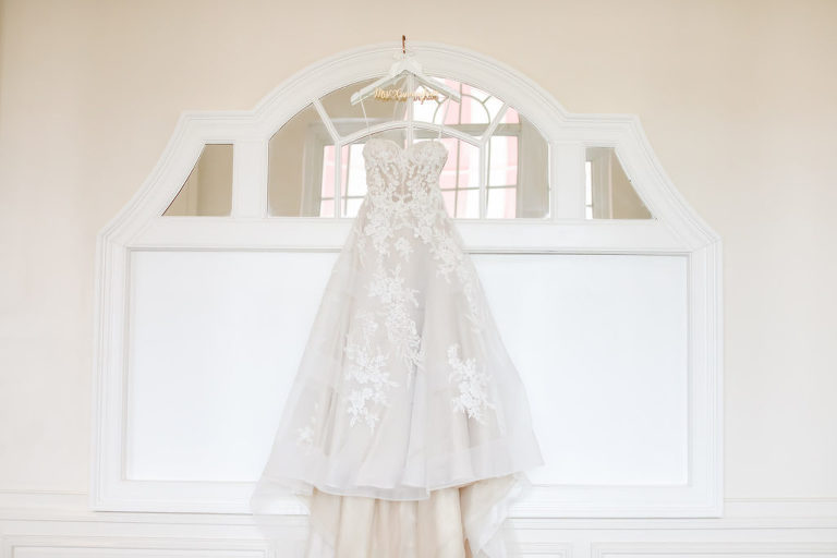 Romantic Ballgown Tulle and Lace Hanging Wedding Dress on Custom Hanger | St. Petersburg Wedding Venue The Don Cesar | Tampa Bay Bridal Salon Isabel O'Neil Bridal | Florida Wedding Photographer Lifelong Photography Studio