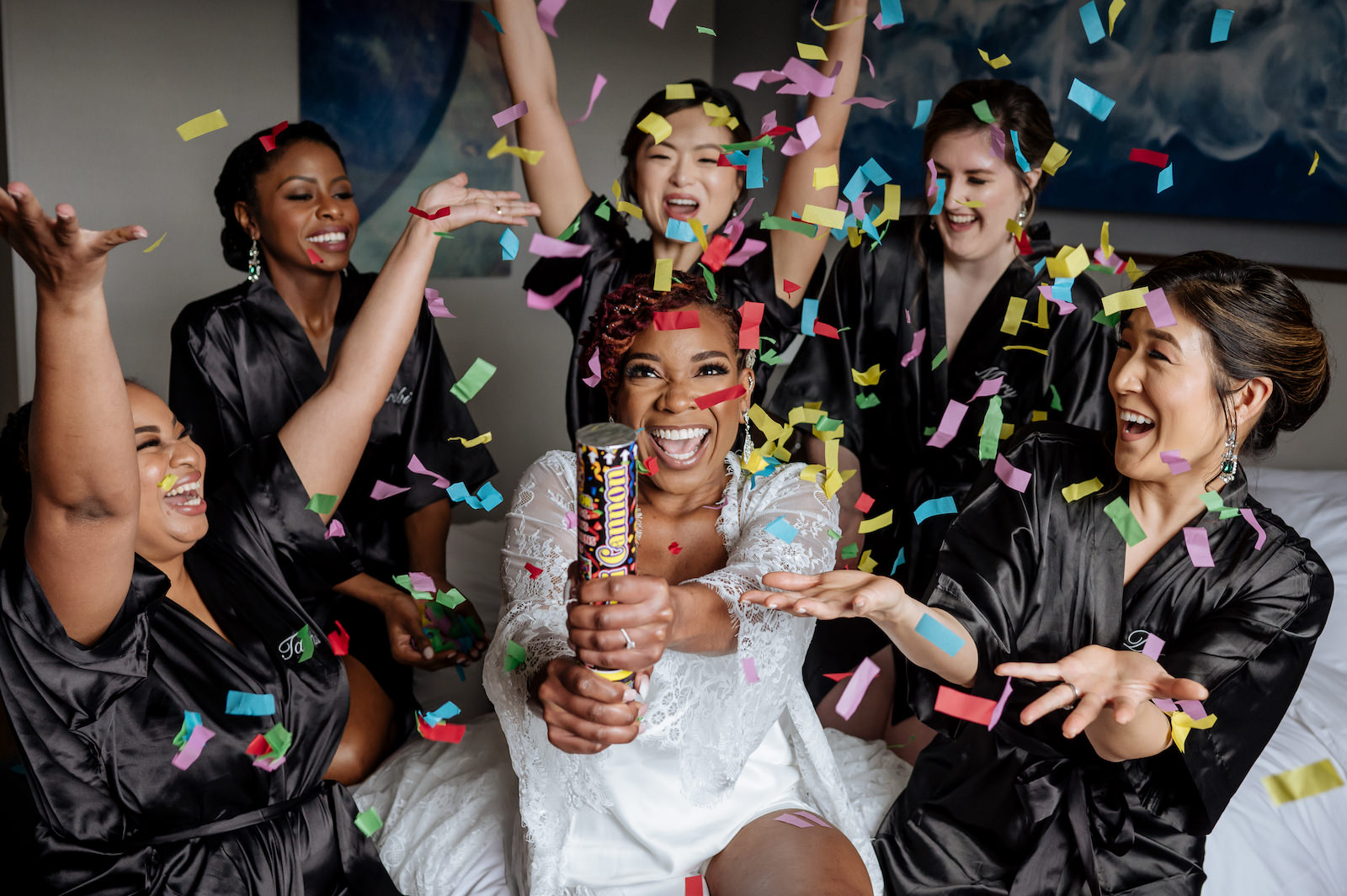 Bride and Bridesmaids Getting Ready in Black Silk Robes and White Lace Robe with Confetti Cannon Popper