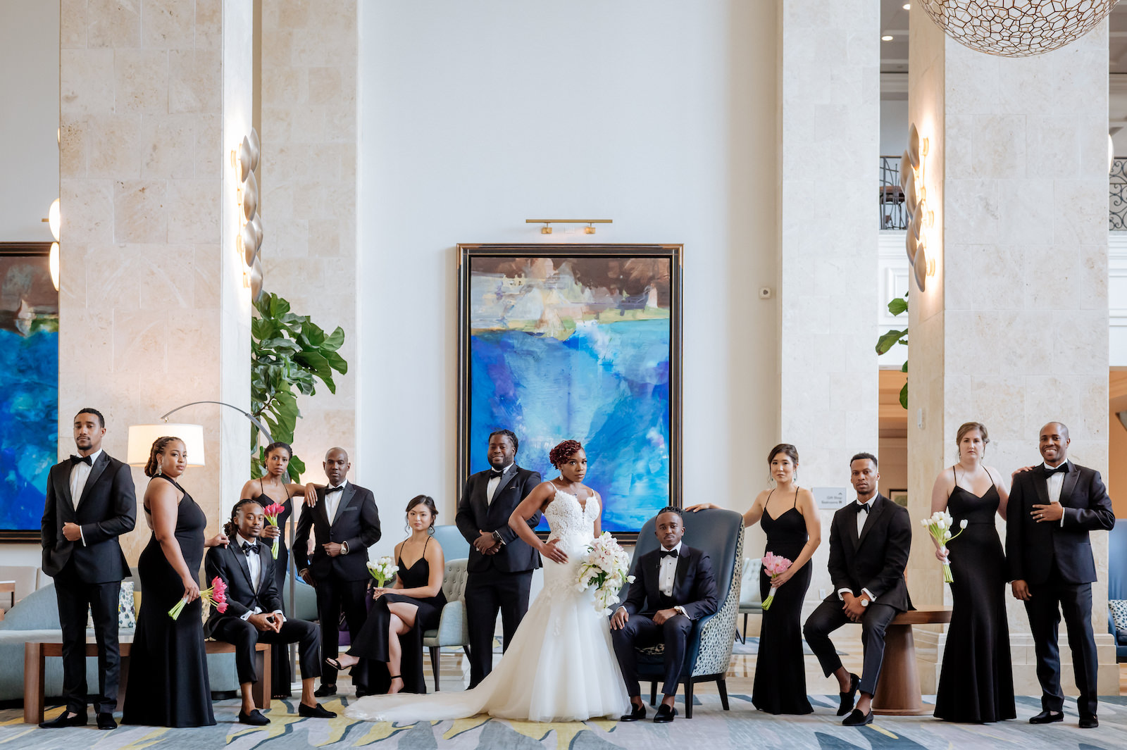 Black and White Wedding Party Indoor Portrait   Groom Wearing Modern Navy Suit with Black Satin Lapel and Bow Tie   Ivory Spaghetti Strap Scoop Back Lace and Tulle Mermaid Martina Liana Wedding Dress Bridal Gown   Black Long Jenny Yoo Bridesmaid Dresses from Tampa Dress Shop Bella Bridesmaids   The Black Tux Groomsmen Suits