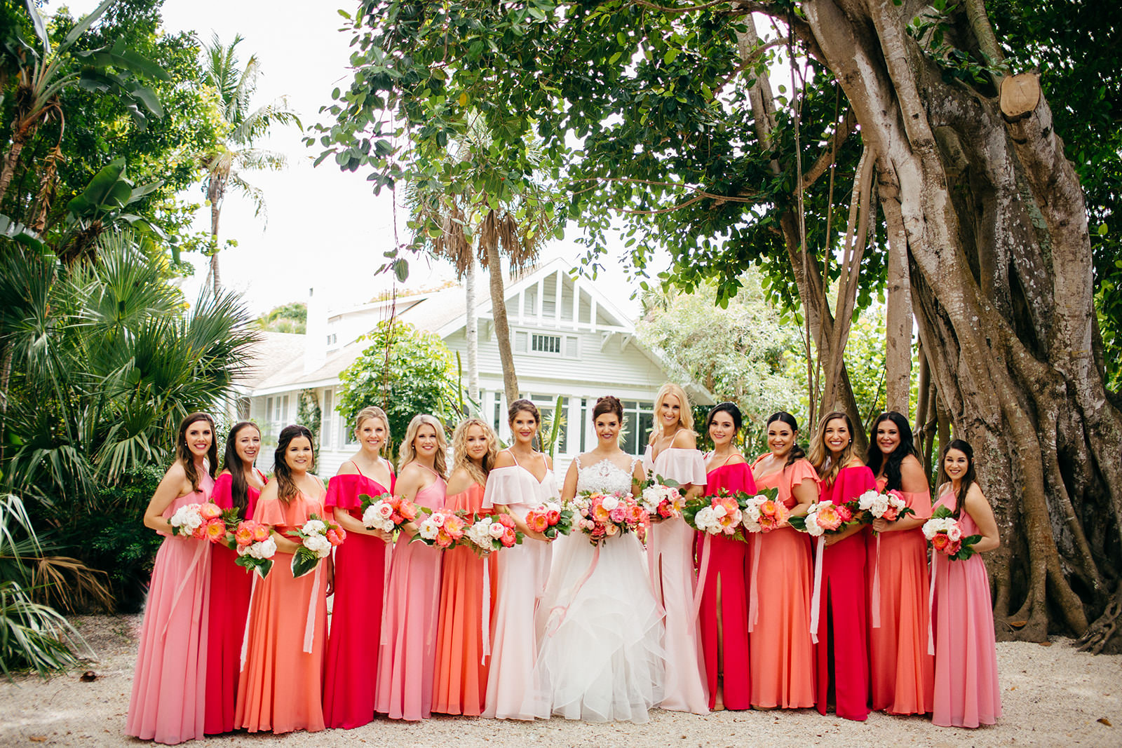 Tropical Vibrant Bride and Bridesmaids in Pink and Coral Dresses
