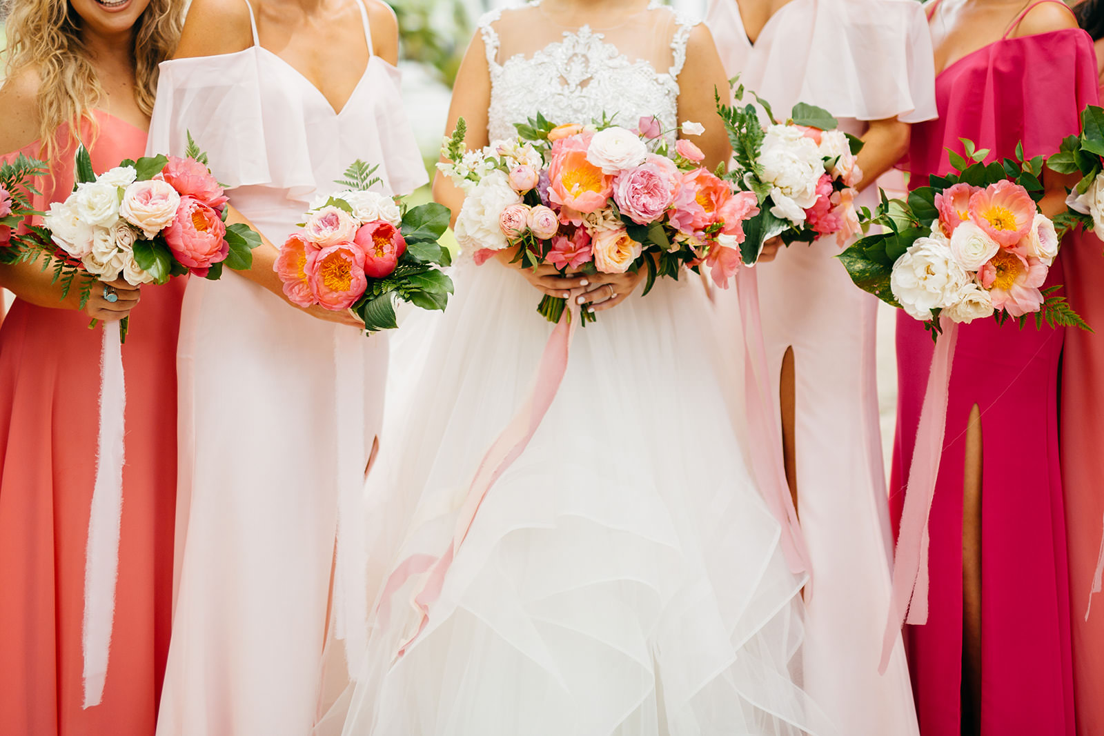 Tropical Vibrant Bride and Bridesmaids in Pink and Coral Dresses Holding Colorful Pink and White Roses Floral Bouquets