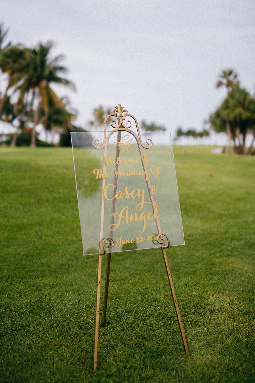 Elegant Tropical Wedding Ceremony Decor, Modern Acrylic and Gold Font Sign   Tampa Bay Wedding Planner NK Weddings
