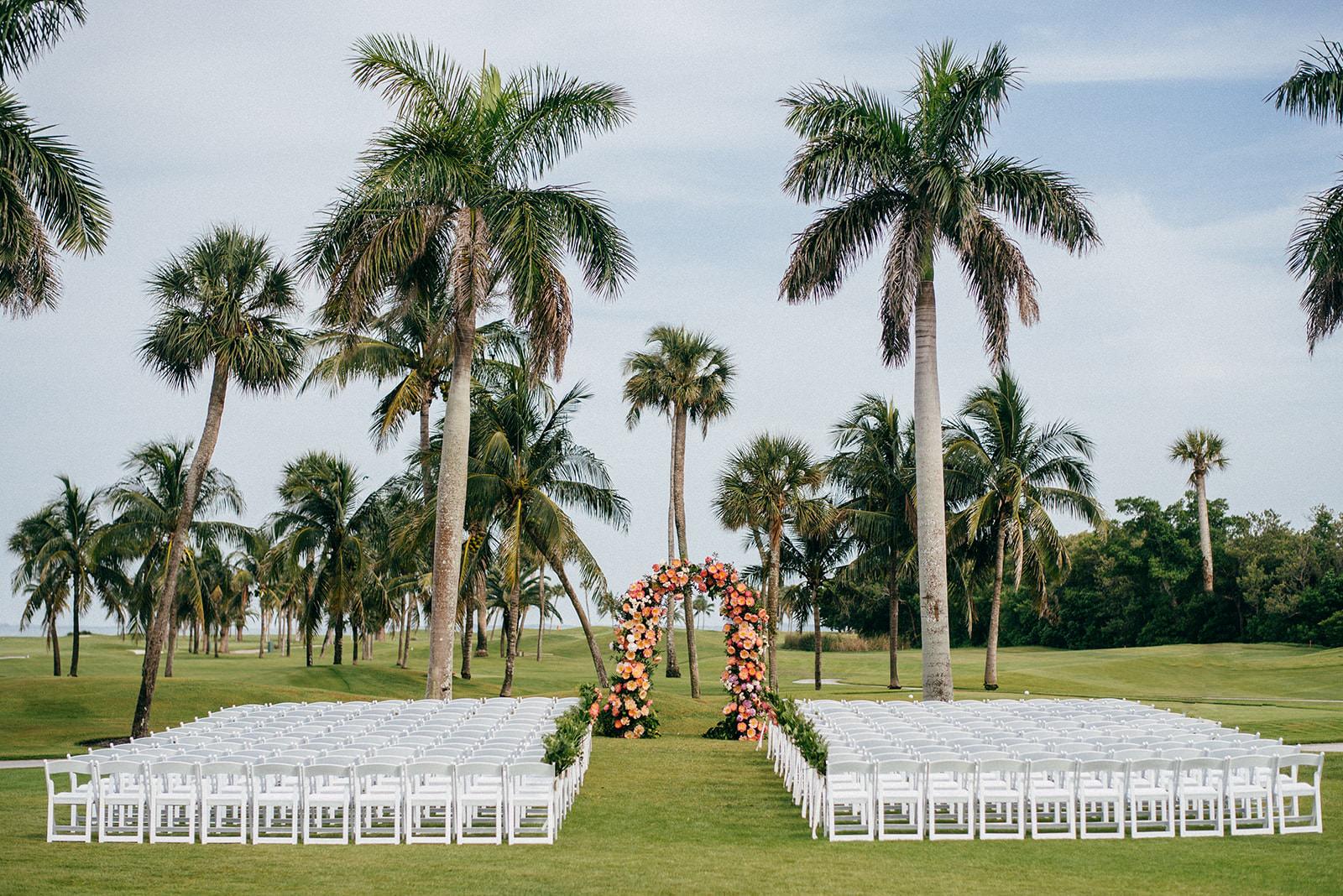Tropical Wedding Ceremony Decor, Colorful Pink and Coral Floral Arch   Boca Grande Wedding Venue Gasparilla Inn   Tampa Bay Wedding Planner NK Weddings