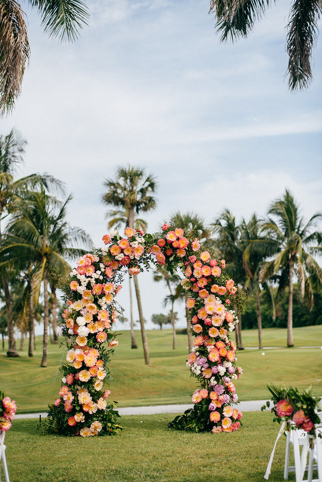 Tropical Wedding Ceremony Decor, Pink and Coral Lush Floral Arch   Boca Grande Wedding Venue Gasparilla Inn   Tampa Bay Wedding Planner NK Weddings