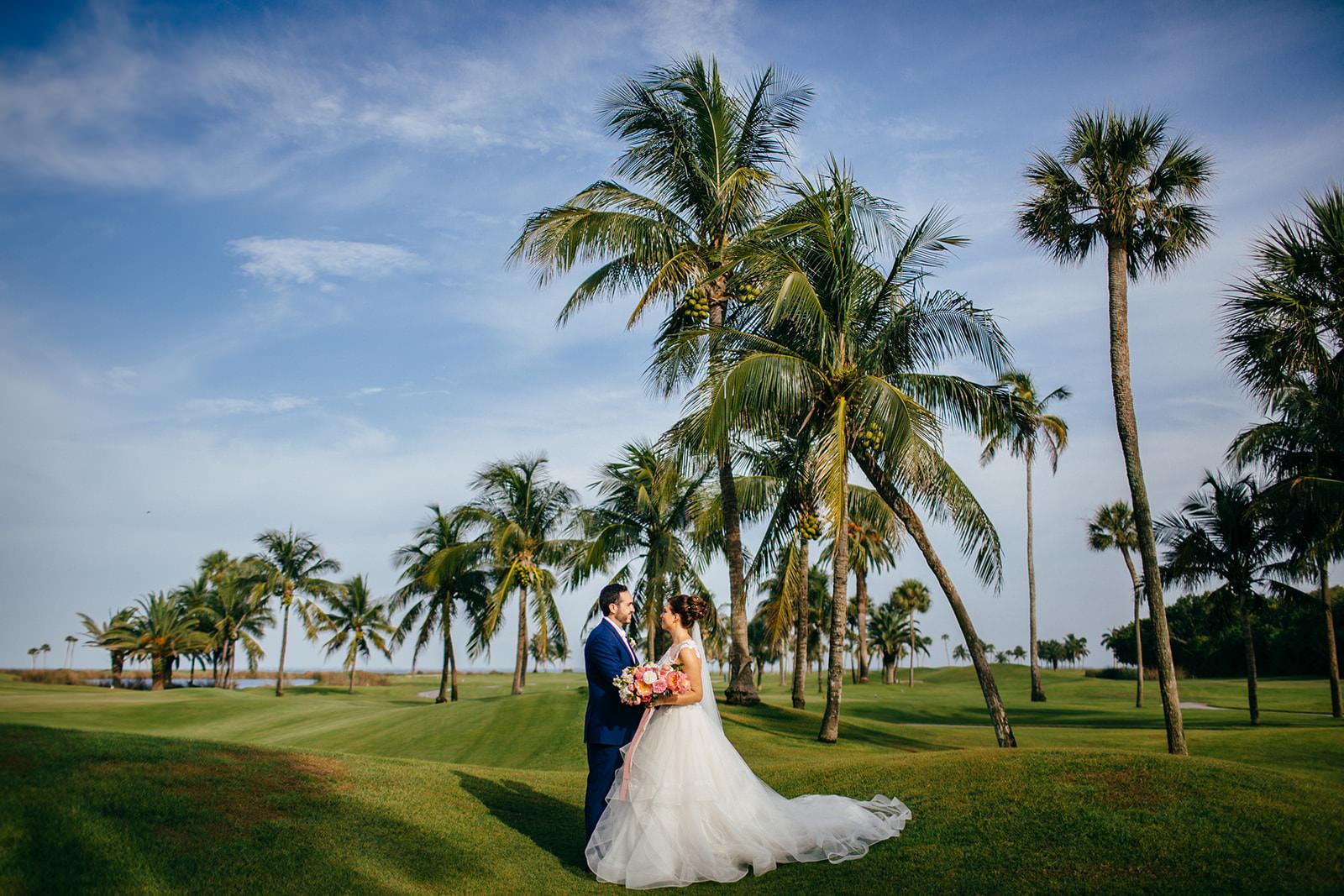 Tropical Tampa Bride and Groom on Golf Course at Boca Grande Wedding Venue Gasparilla Inn