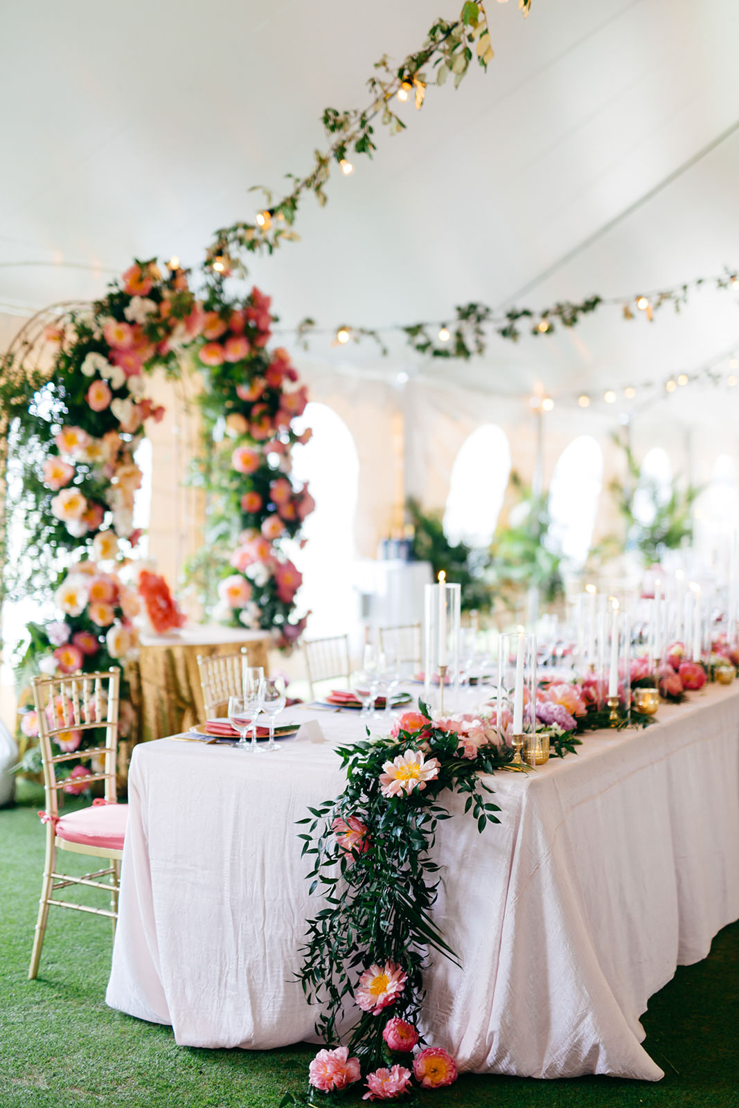 Elegant Tropical Tent Wedding Reception Decor, Pink and Coral with Greenery Floral Table Runner, Gold Chiavari Chairs with Pink Cushions   Tampa Bay Wedding Planner NK Weddings