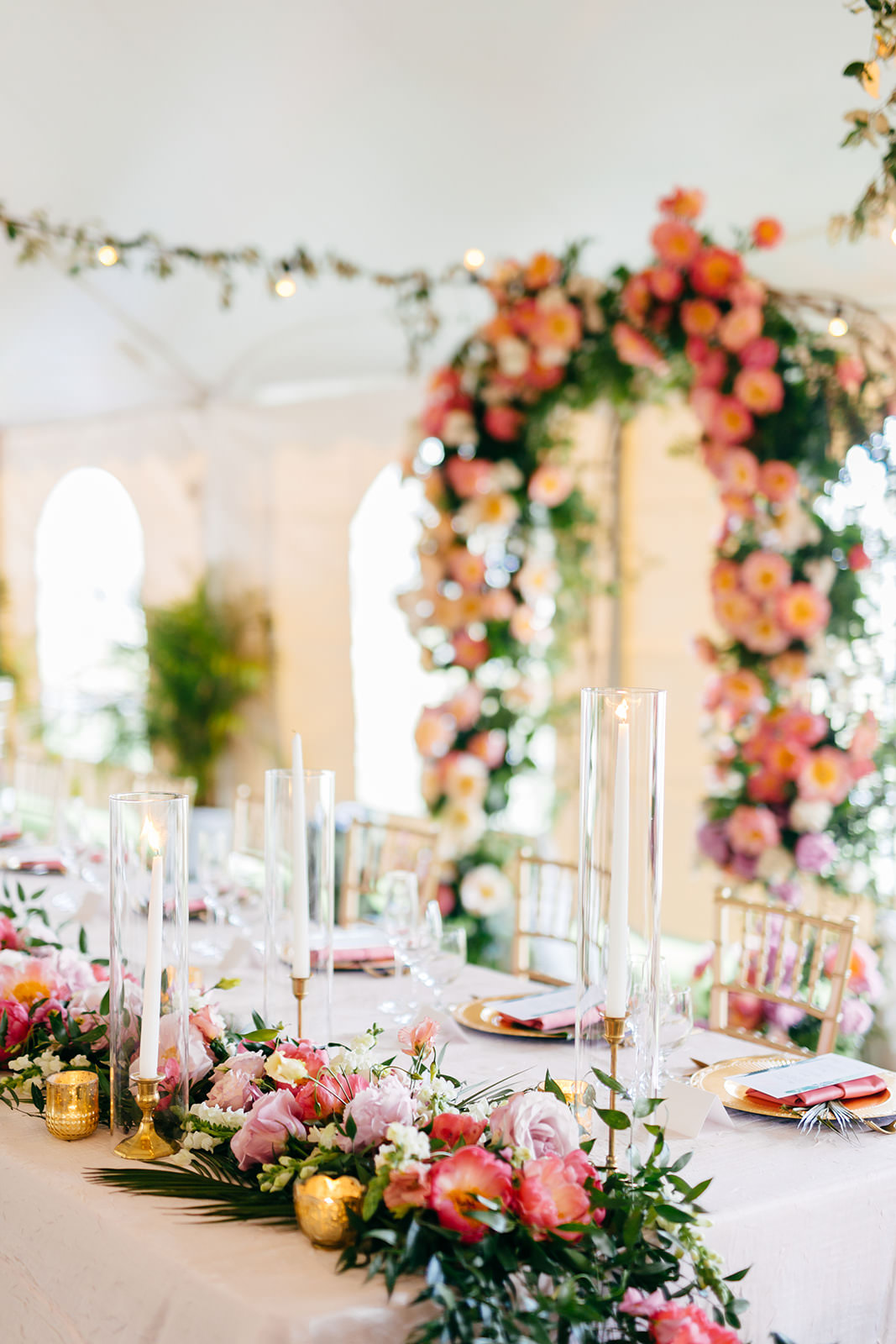 Elegant Tropical Wedding Reception Decor, Lush Pink and Coral with Greenery Floral Table Runner, Gold Candlesticks   Tampa Bay Wedding Planner NK Weddings